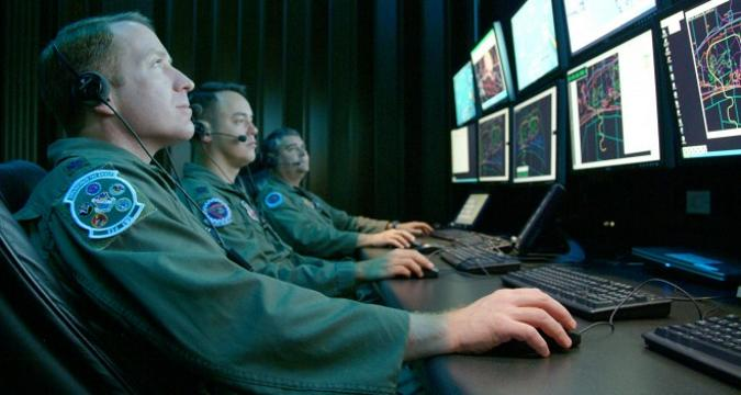 US soldiers in front of computers