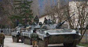 Ukrainian separatists with Russian tanks