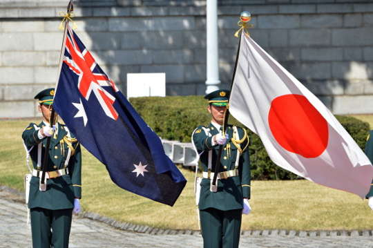Australian and Japanese flags. Soldiers.