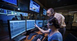 People monitoring screens