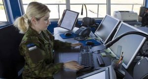 Estonian female soldier in front of computers