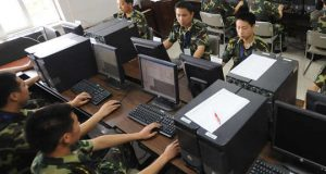Chinese soldiers in front of computers