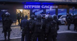 Police in front of hyper cacher store in Paris.